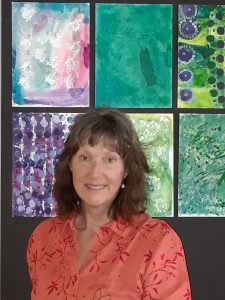 Elizabeth Stanbro with art based on Opening Minds Through Art