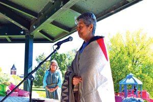Lucille Echohawk leading a prayer